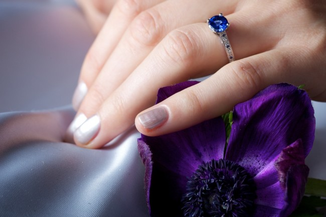 Manicured hand with sapphire ring and anenome