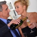 Rings with love - special occasions - Mature couple celebrating with champagne